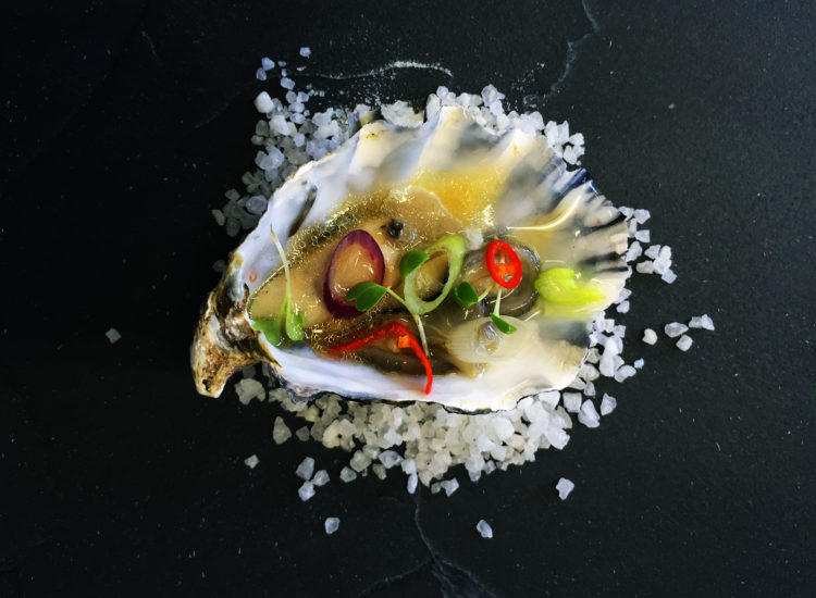 Oyster with ginger and rice wine vinaigrette, chilli, coriander and fresh spring onion