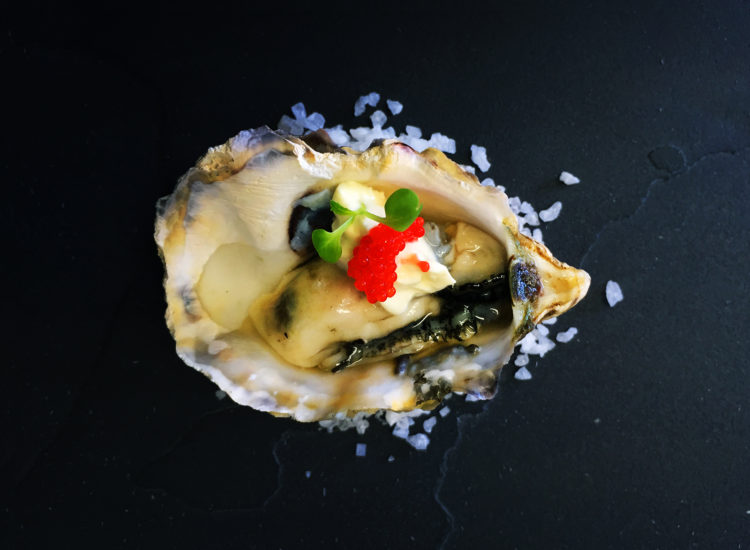 Oyster with lemon crème fraiche and salmon roe