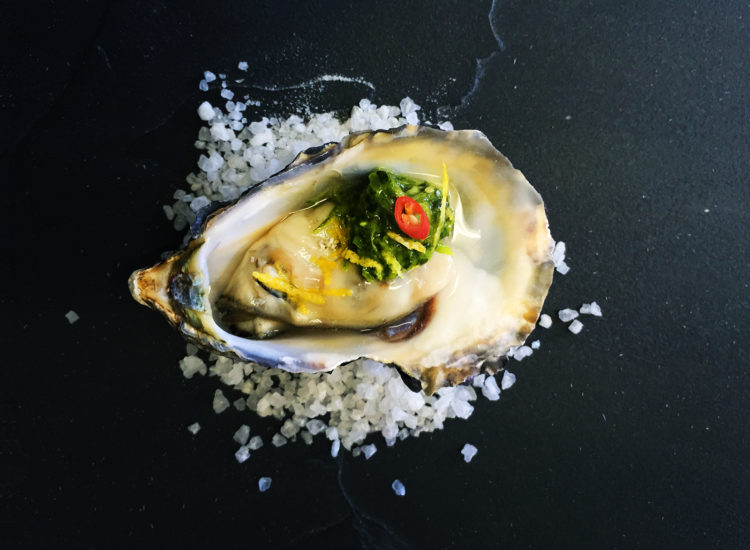 Oyster with spicy chimichurri, coriander cress and lemon zest