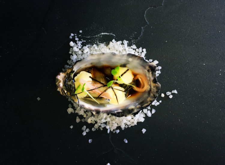 Oyster with sushi style pickled ginger, nori crips, soy sauce, wasabi kewpie mayo