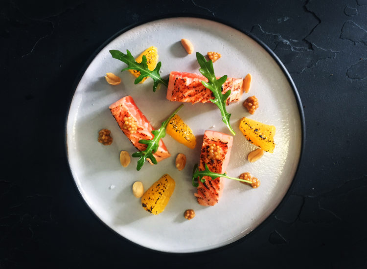 Salmon charred ceviche slices, orange, mustard, watercress, peanuts, honey citrus dressing