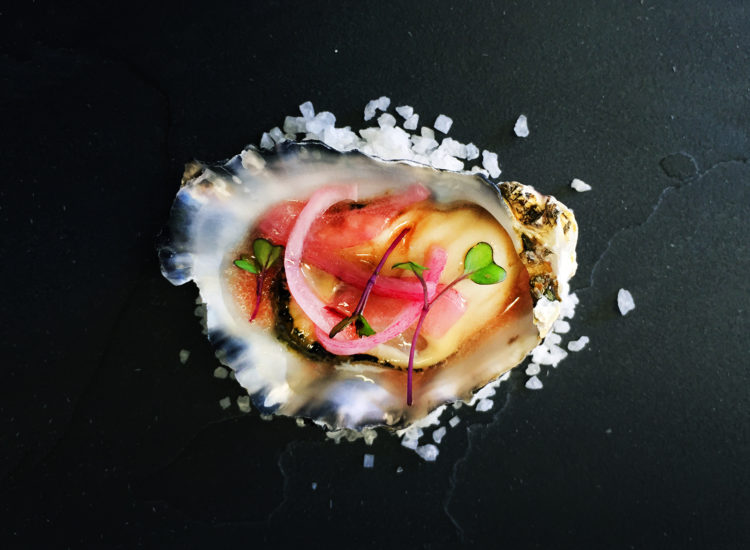 Oyster with pickled red onion, parsley and red wine vinaigrette