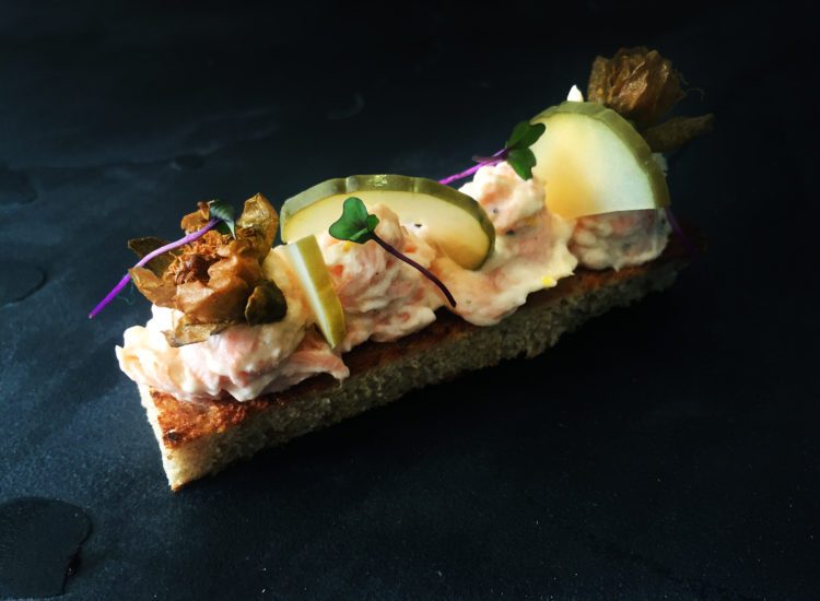 Salmon pate served with toasted flatbreads, deep fried capers, chopped gerkins, preserved lemon and a dill crème fraiche